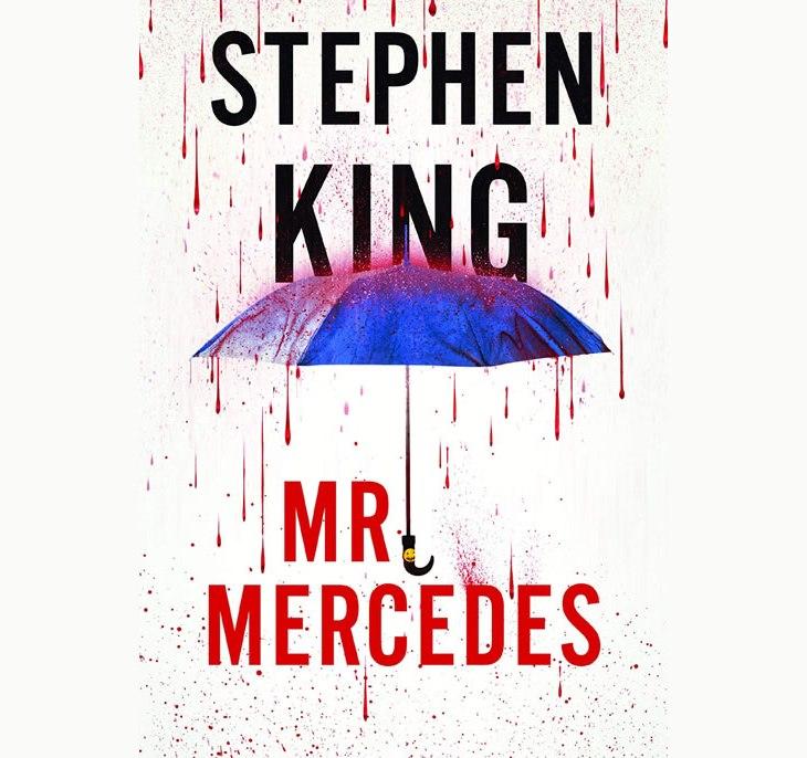 Resenha do livro Mr. Mercedes, de Stephen King: a capa do livro, com gotas de sangue caindo sobre um guarda-chuva azul